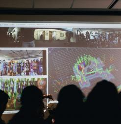 Participants view a presentation of live images of how a robot senses its environment.